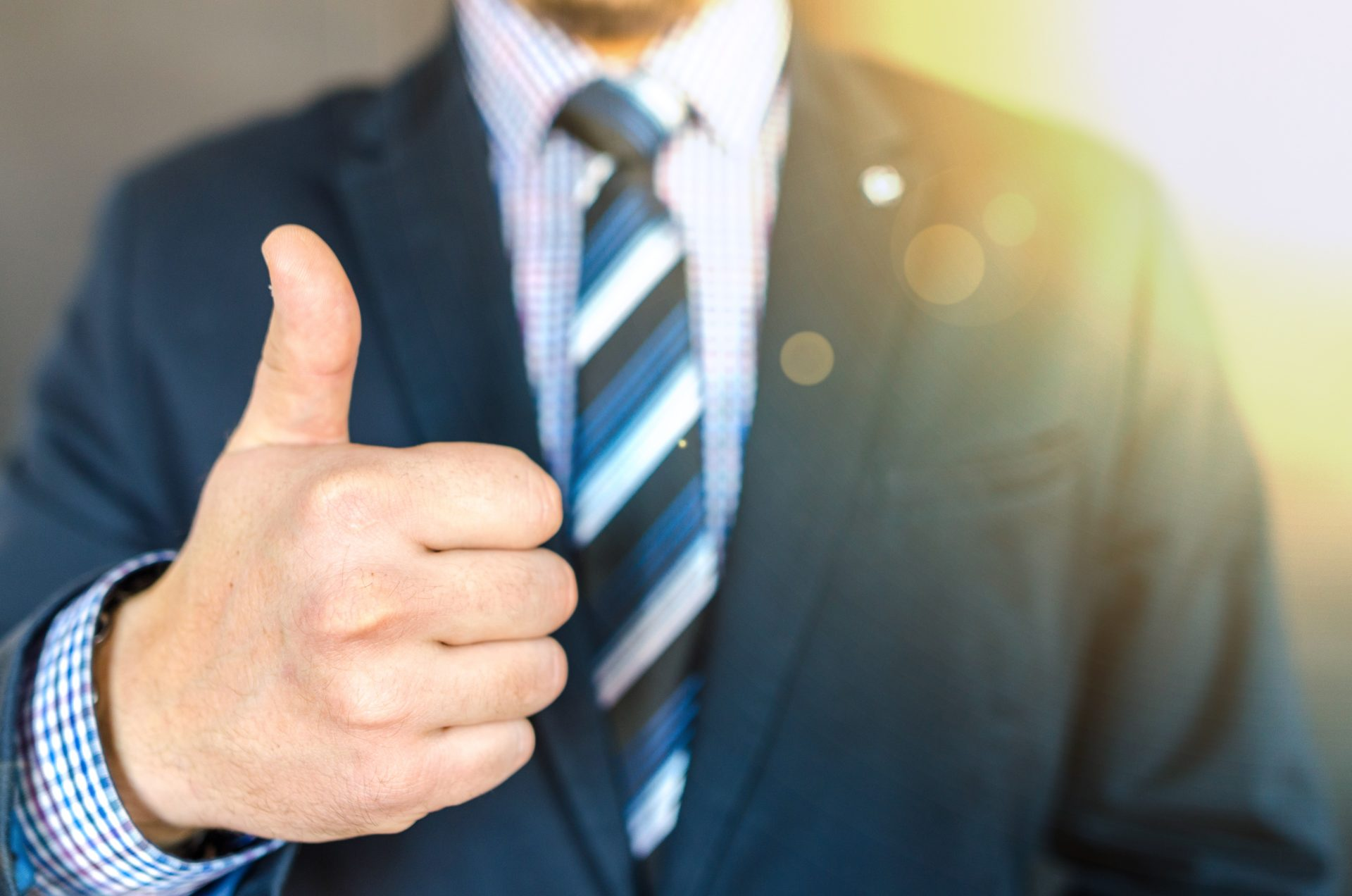 Man in suit giving thumbs up