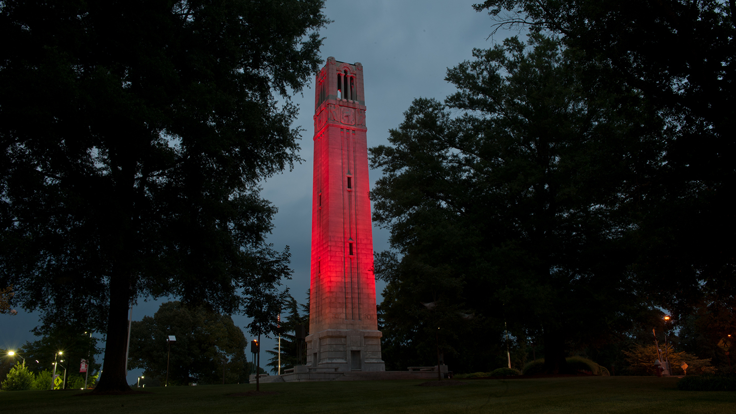 Belltower lit red at night