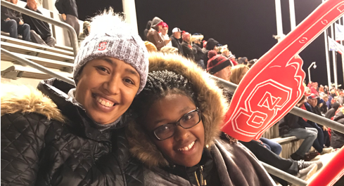 Hakima Harris (left) and her daughter at an NC State football game a month before her cancer surgery