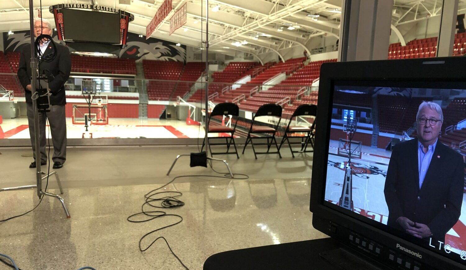 A camera crew records Chancellor Randy Woodson's remarks in Reynolds Coliseum, where Convocation normally takes place.