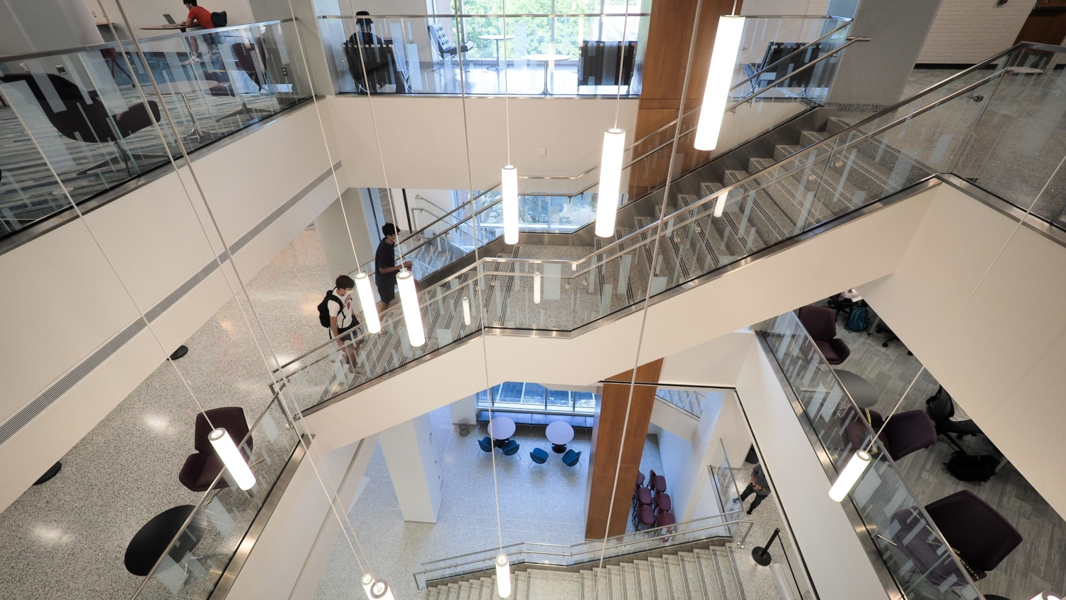 Students make their way up the central stairwell in the newly renovated D.H. Hill Library on the first day of classes, 2020.