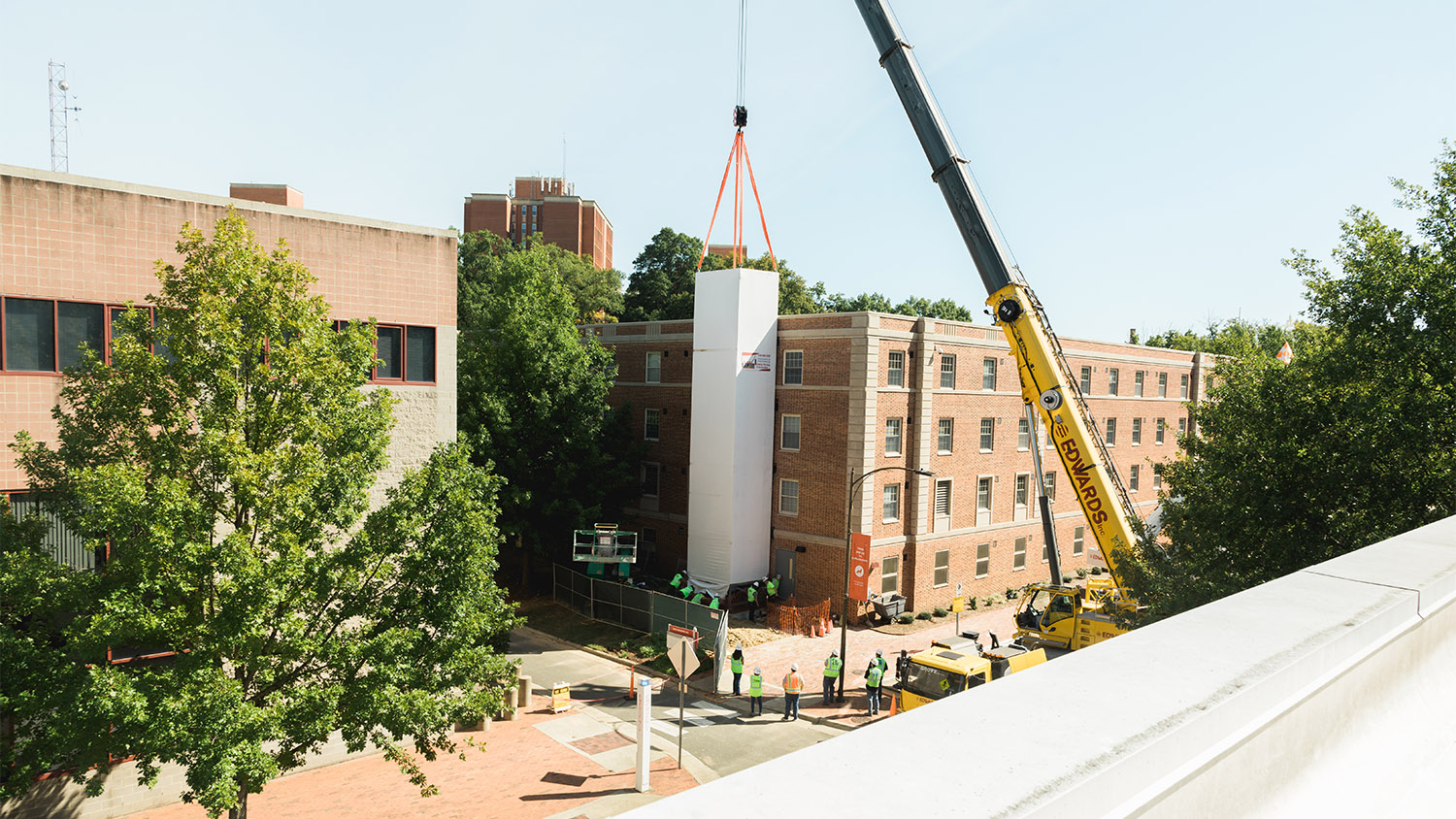 A construction crane places the elevator shaft on the side of Tucker Hall