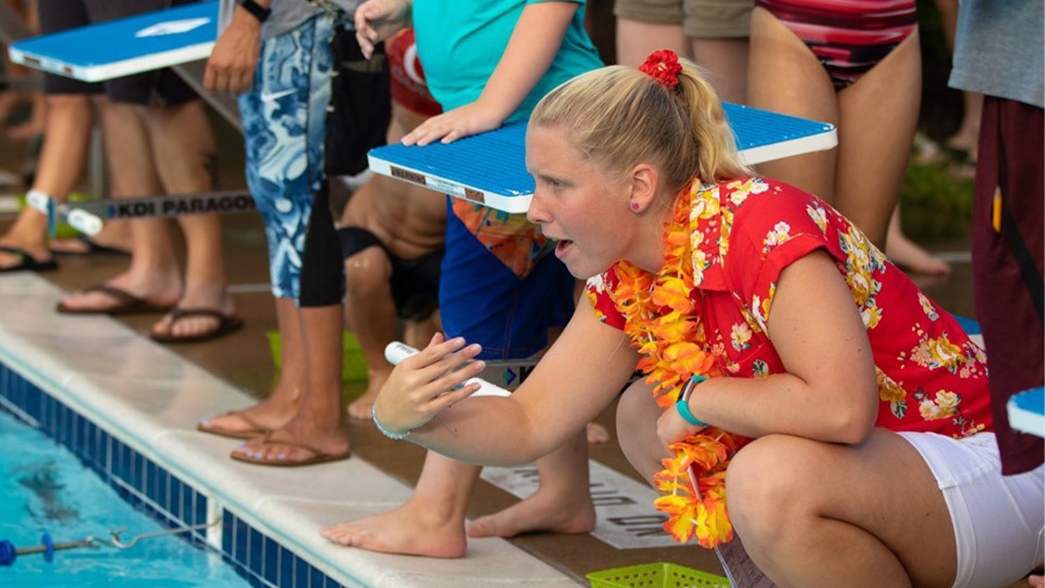 Crista Bain coaching swimmers at Athens Drive Magnet High School in Summer 2019