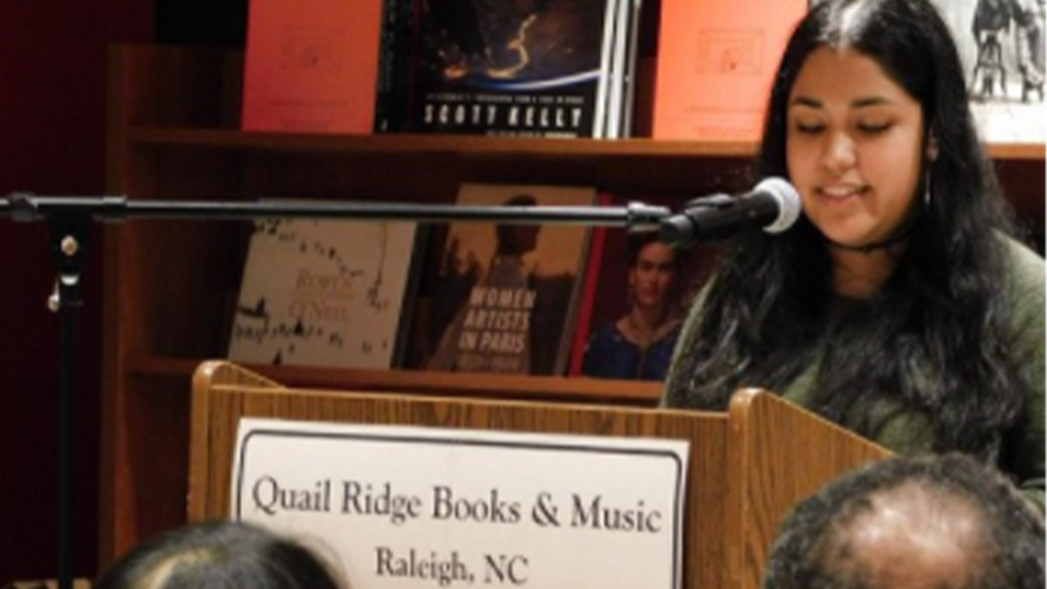 Briza Cruz gives a reading at a local bookstore