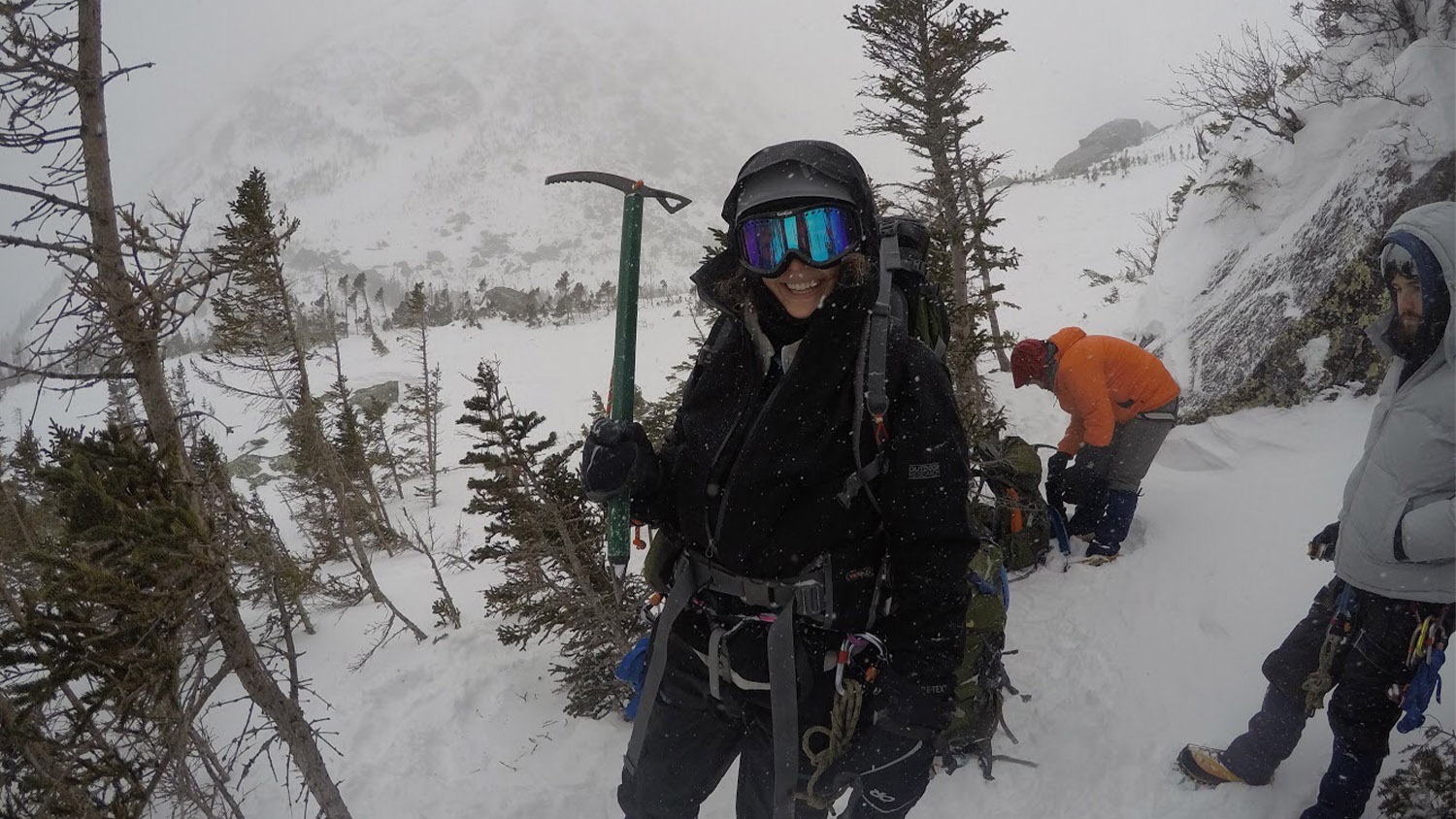 Alyssa Stroker holds a pick axe during a mountain climb in the snow