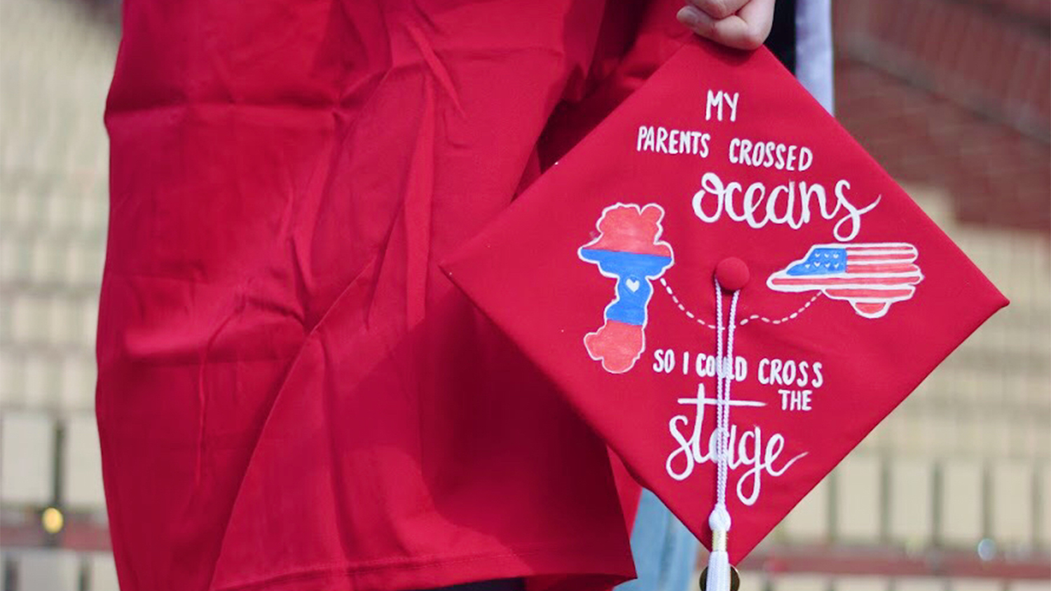 """A graduation cap that reads """"My grandparents crossed oceans so I could cross the stage"""""""
