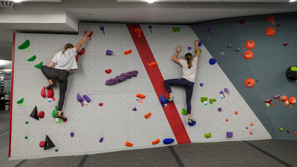 Students practice climbing and bouldering during the COVID-19 pandemic at the newly renovated Carmichael gym. Photo by Marc Hall