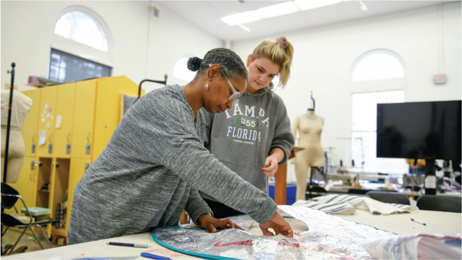A faculty member and student work in a research lab together