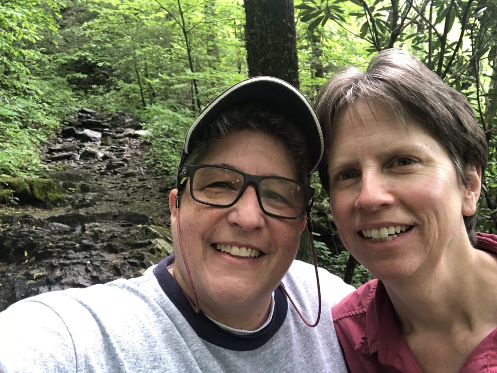 Justine Hollingshead and her wife, Debbie Dean on a hike in nature