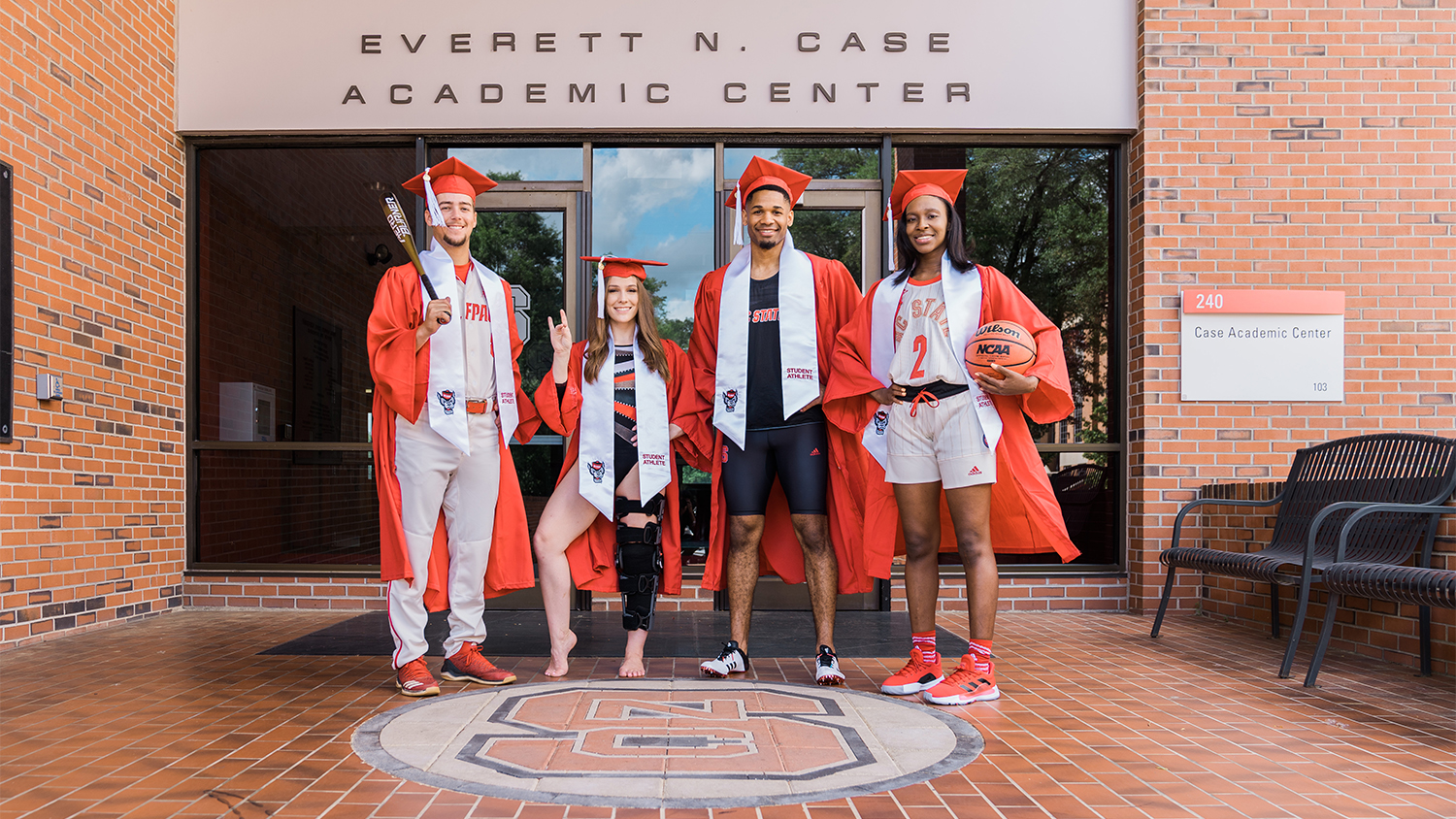 A group of four student-athletes outside the Everett N. Case Academic Center
