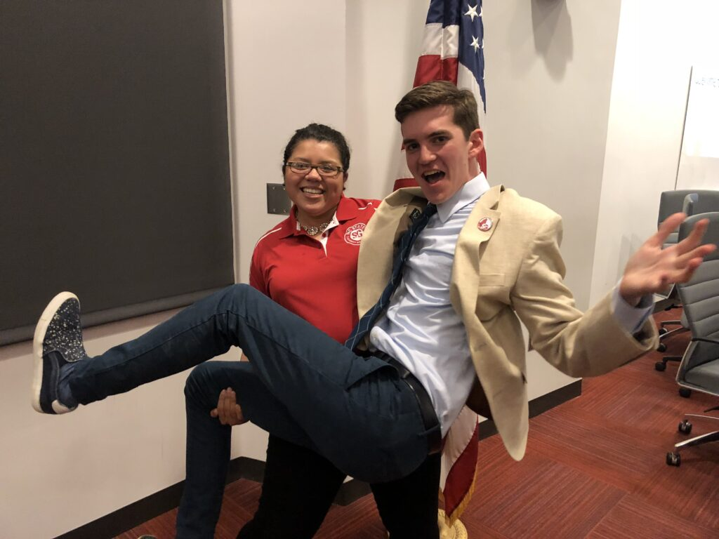 Gonzalez lifts Moravec for a funny pose after a Student Government meeting