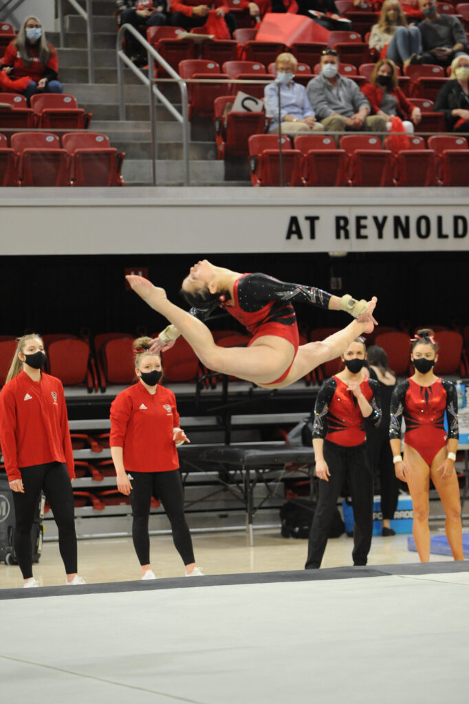 Chloe Negrete completes a jump during a gymnastics competition in Reynolds Coliseum