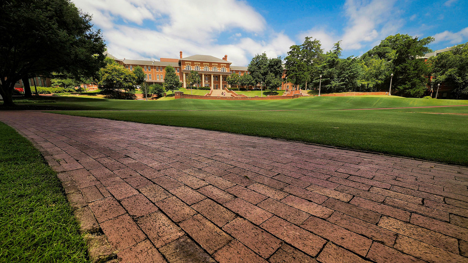Close-up of brick path with the Court of Carolina in the background