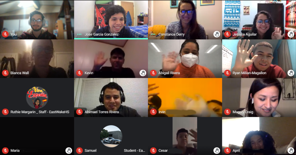 A screenshot of a Zoom call with 16 windows showing students waving and smiling