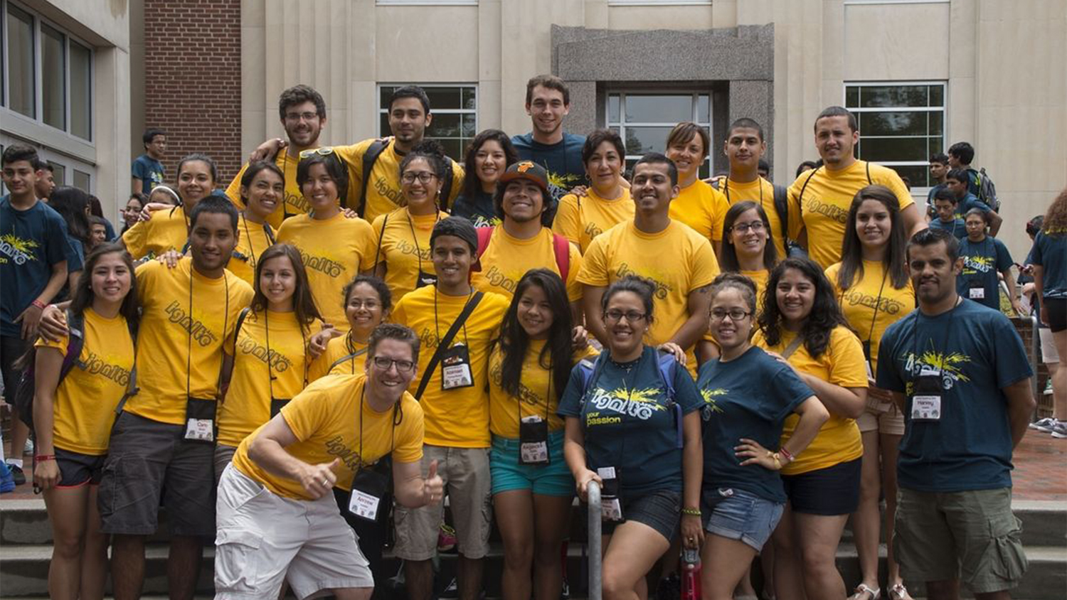 A group of students in yellow shirts