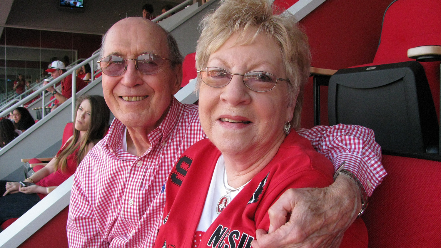 Curtis and Barbara Freeze in the stands at an NC State football game