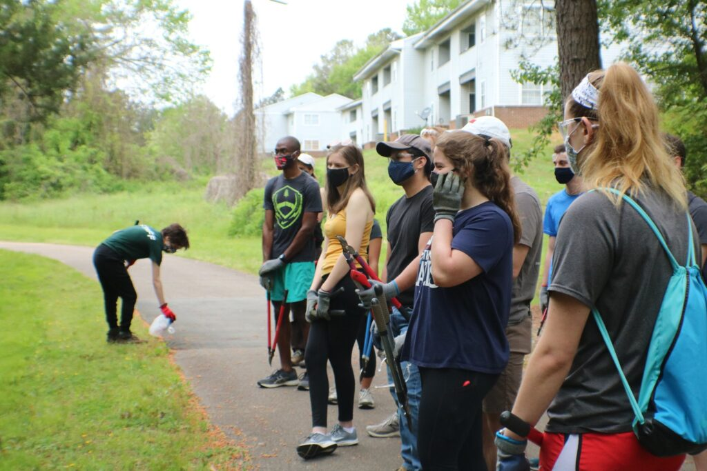 Students preparing to clean up a greenway in Raleigh as part of a Mystery Service Saturday trip