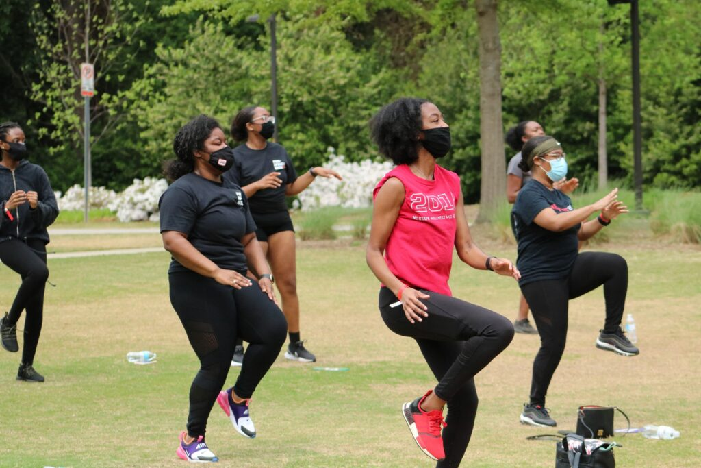 Students get moving on Stafford Commons as part of last year's PanAfrican Week Trap Fit event