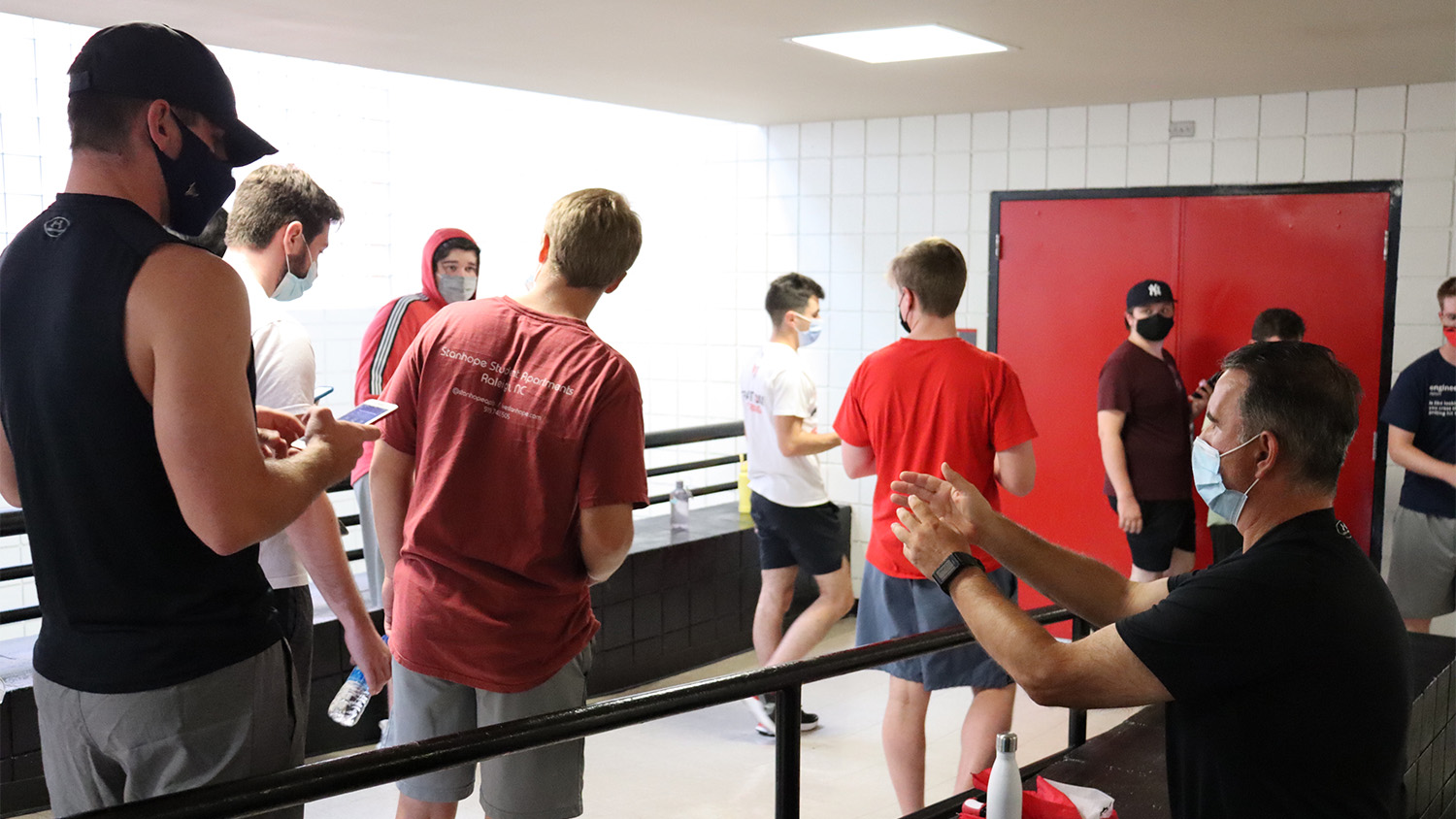 Professor Peter Koutroumpis talks to students in his Fitness Walking class.