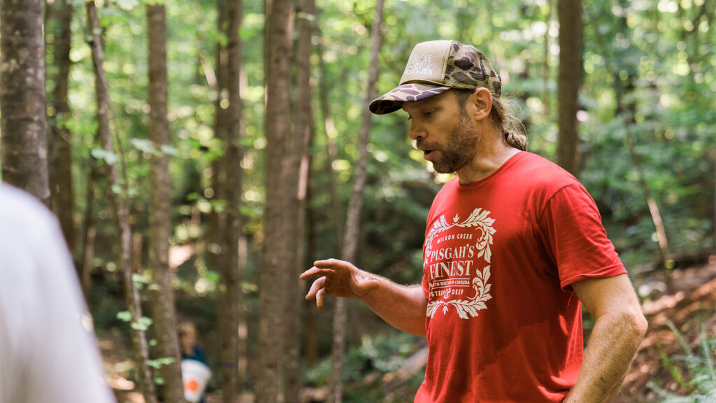 Kristian Jackson in Lake Raleigh Woods, helping reroute a bike trail