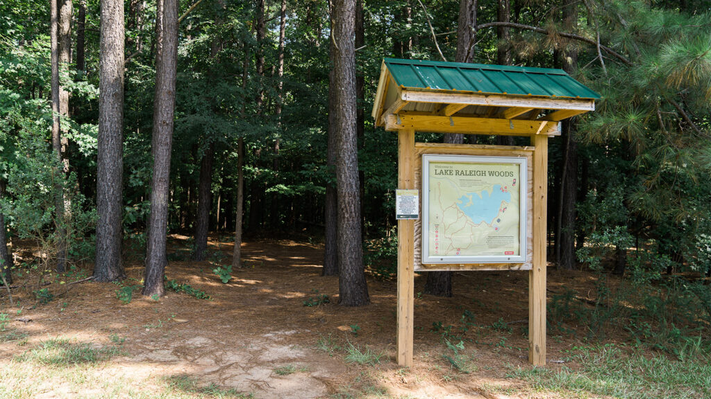 A sign at the trail head for Lake Raleigh Woods, next to the middle school on Centennial Campus