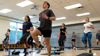 Students take H.I.I.T Group Fitness class