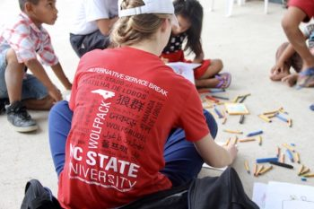 NC State students working with children