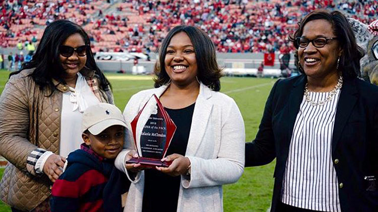 Malasia McClendon receiving the Leader of the Pack award