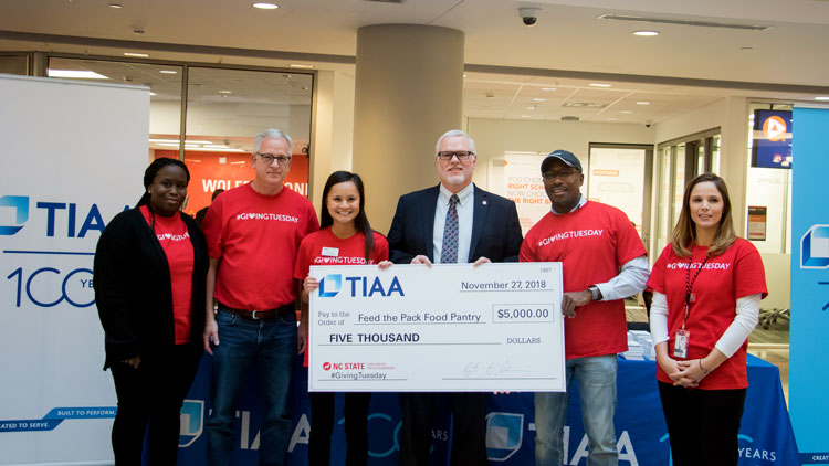 TIAA gives a donation in support of Giving Tuesday