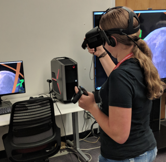UB Participants experimenting with AR/VR hardware/software in the University Library's Virtual Reality Studio.