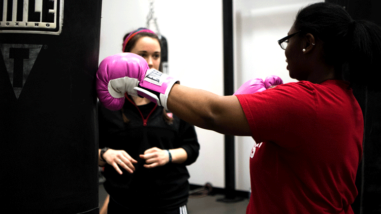 Students taking boxing class