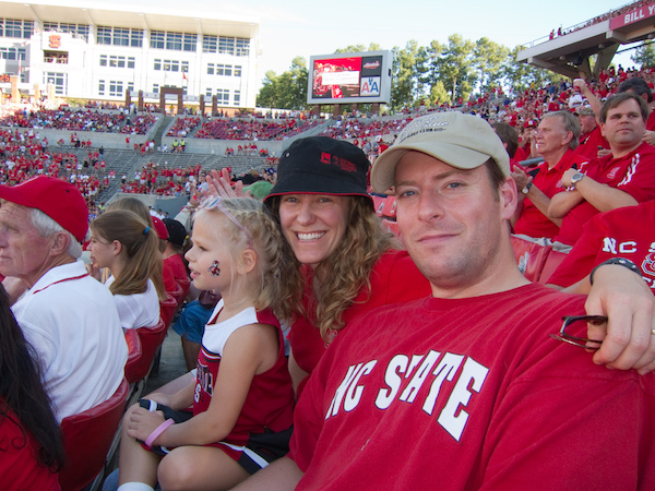 Michelle Wobker with daughter and husband at NC State football game.