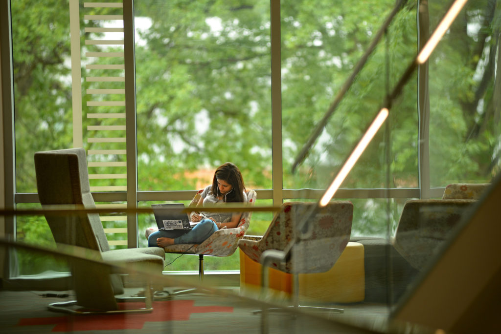 Student relaxes in Talley Student Union.