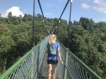 Katie Ryan walks across a suspension bridge in Singapore