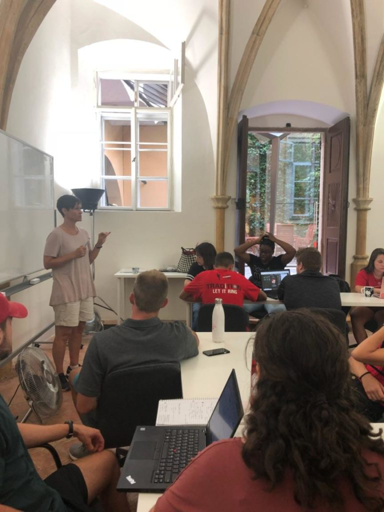 Debbie Acker teaches her course to students in Prague.
