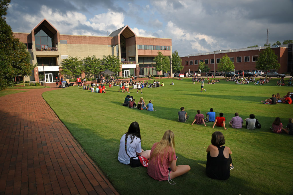 Students sit on the lawn outside Witherspoon