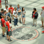 New students learn to walk around the seal in Talley Student Union during orientation.