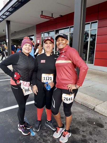 Peter Koutroumpis, Joy Kagendo, Peggy Domingue, and Renee Harrington pose together at the race.