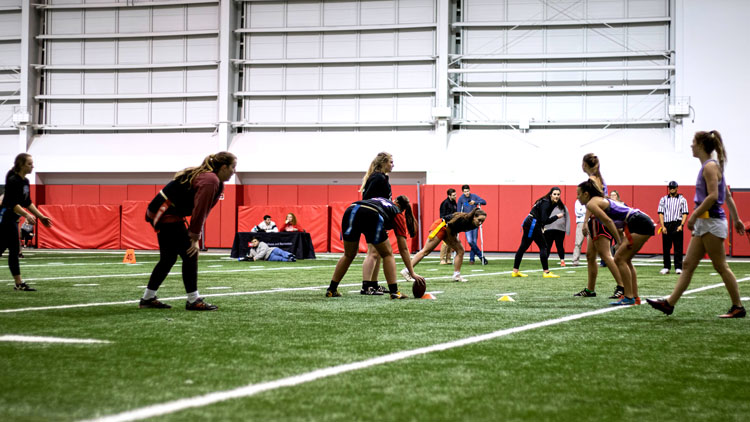 Chi Omega members playing flag football.