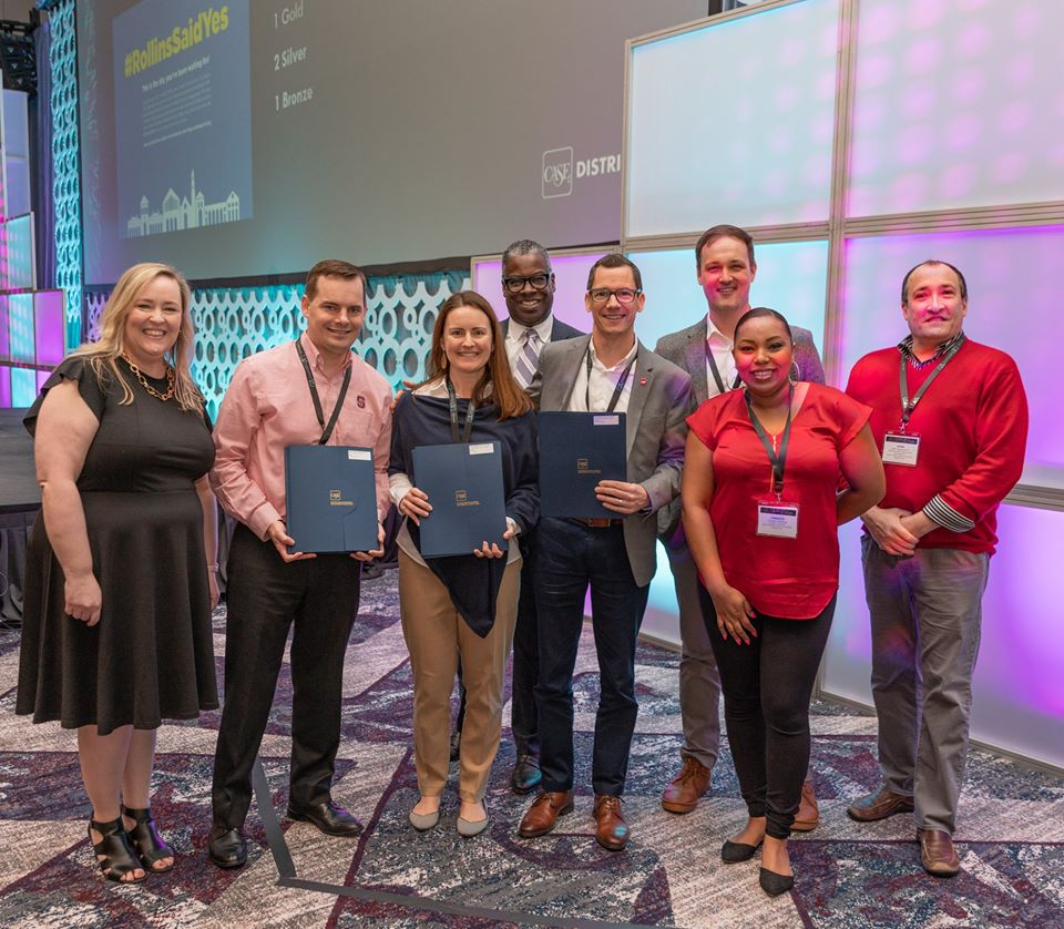 NC State marketing staff accept awards at the CASE District III conference in February