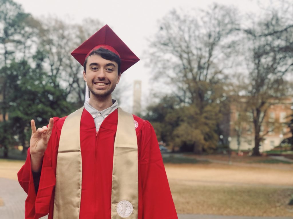 Colton Botta in his NC State University graduation robes