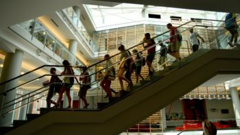 Students walk down stairs in Talley Student Union during DASA orientation
