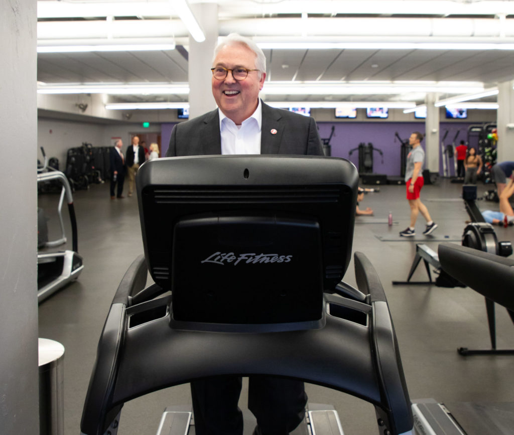 Chancellor Randy Woodson uses a treadmill at the Wellness and Recreation Center during his tour of the facilities