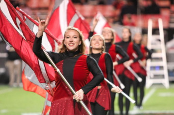 Jena Phillips performs with the color guard for the NC State marching band