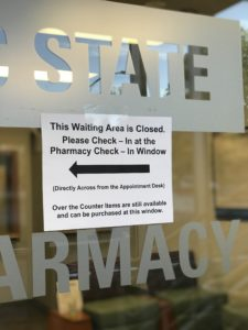 A sign indicating that the Health Center waiting room is closed