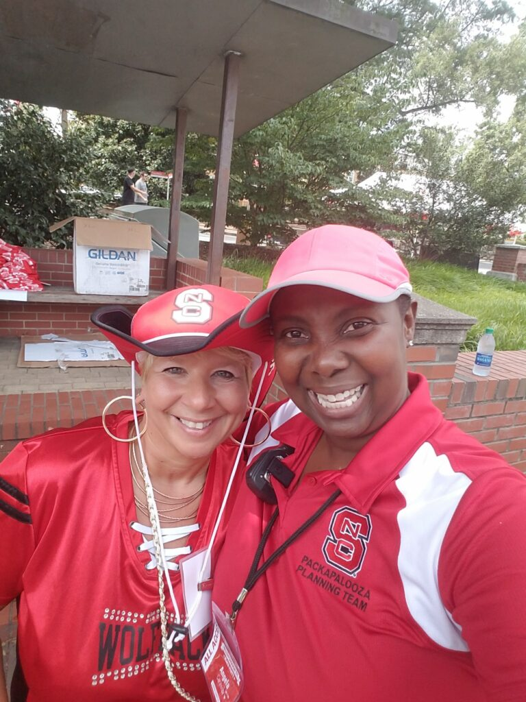 Angela Caraway poses with a fellow NC State fan and Packapalooza attendee.