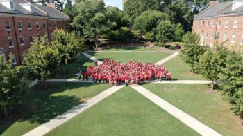 Housing staff pose for an aerial photo on campus