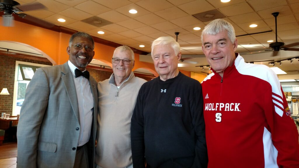 Thomas Conway pictured with other retired NC State administrators at a coffee shop in 2016