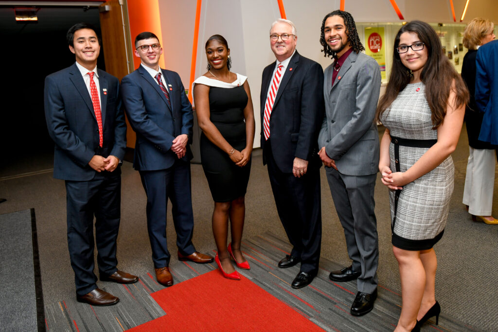 Esmira Poladova (right), Chancellor Woodson, and other TRIO student speakers at Red and White Night